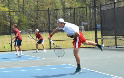 Tennis teams take match