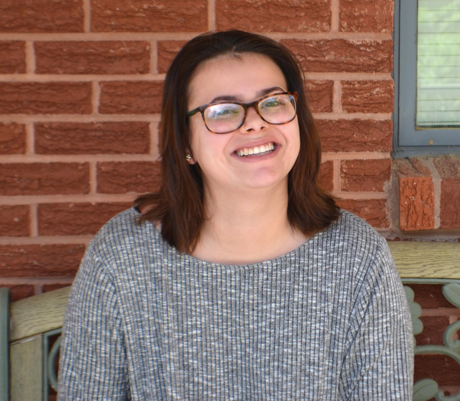 Senior English major Glennie Tanner is involved in many student clubs to improve her photography skills and grow her business.
