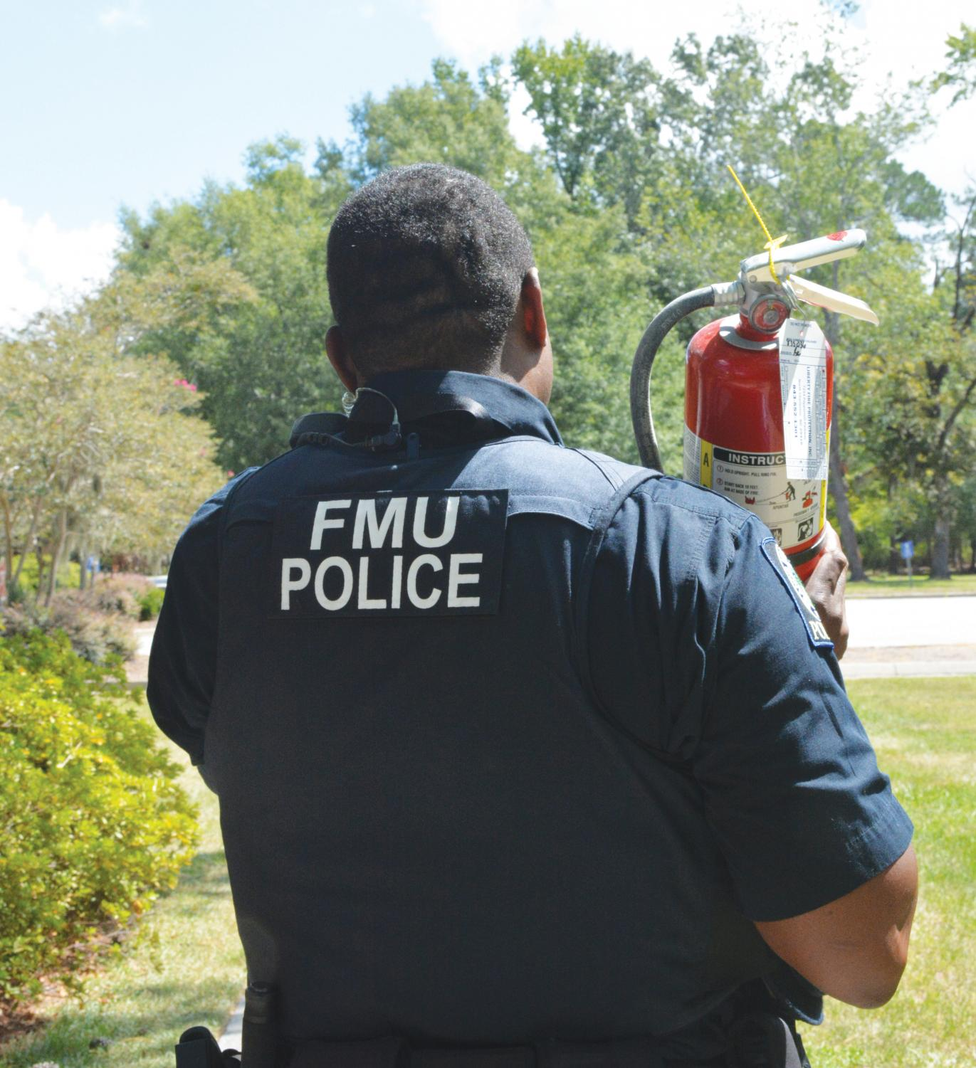 Student Resident Assistants learn important fire safety from FMU Campus Police and Florence County Firefighters.