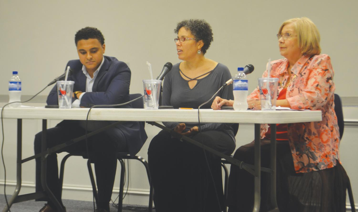 Panelists Michael Youssef, Adalia Ellis-Aroha and Paula McGill speaking to FMU students during an open floor discussion celebrating Hispanic Heritage Month on Sept. 27.