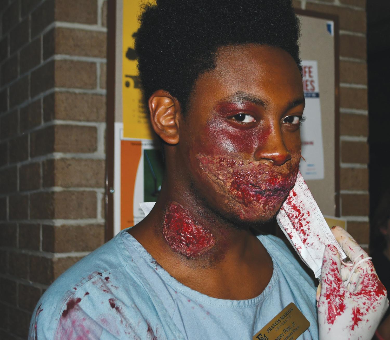 Gregory Pilot dresses in gruesome makeup at Carnevil