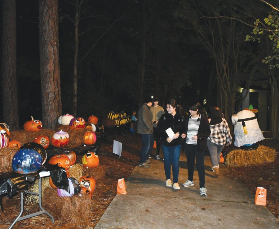 Attendees+walk+the+trail+to+see+pumpkins+from+student+organizations%2C+departments+and+Florence+County+school%27s.