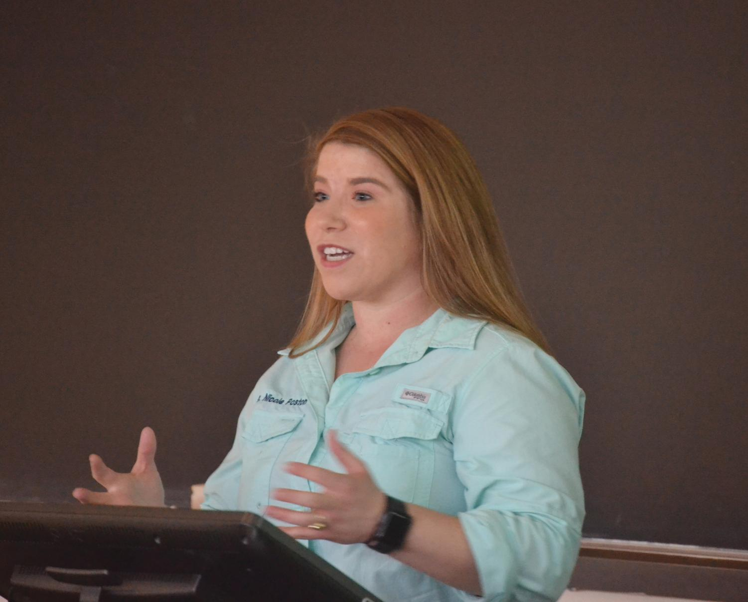 Veterinarian Nicole Poston explains the importance of veterinary science to FMU students.