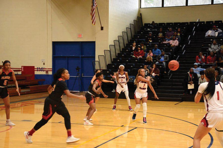 Abigail+Bullock+passes+the+ball+to+Kiana+Adderton.+