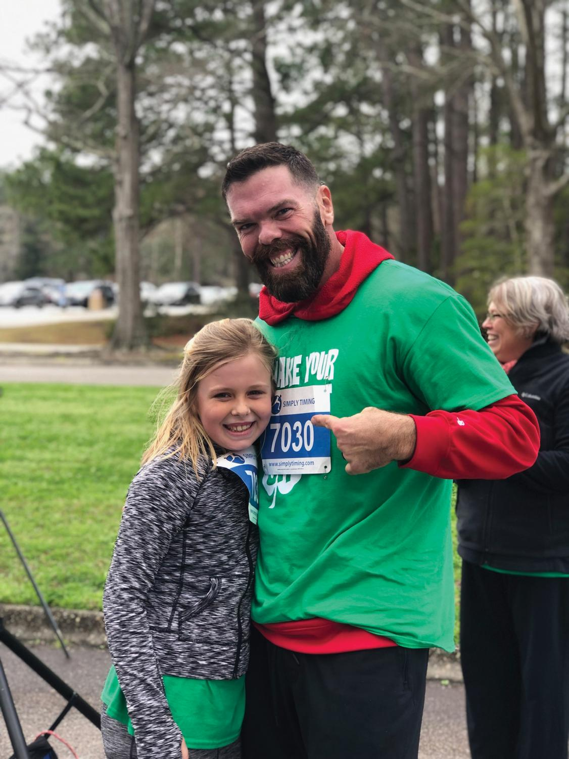 Brian Edwards, one of the winners of the 5K, poses with his daughter, Vivian Edwards.