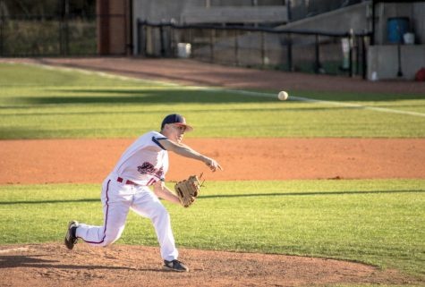 Evan Flynn pitches at the game against Lander University.