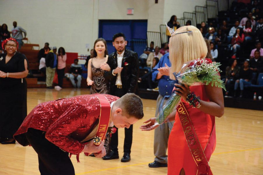 Gabriel+Hutson+bows+to+Shiniyah+Brown+after+they+were+crowned+Homecoming+King+and+Queen.+