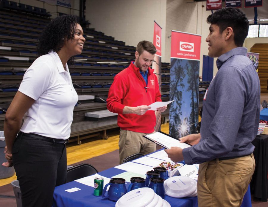 A student networks with potential employers at the career fair.