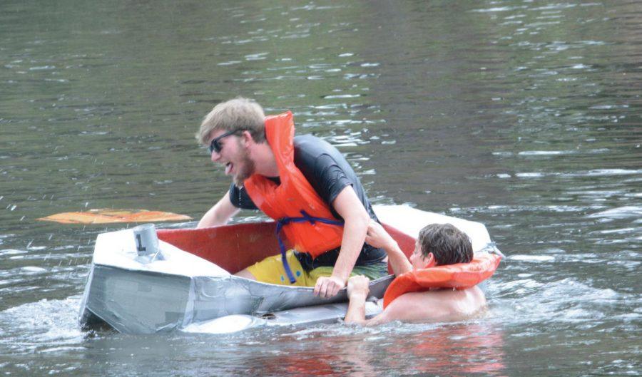 Matthew Mendlesohn tries to flip a fellow contestant in the FMU Cardboard Regatta.