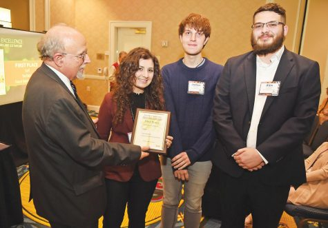 Editor-in-Chief Kaitlyn Luna, Managing Editor Alex Turbeville and Assistant Editor Joshua Hardee accept the award for first place for general excellence.