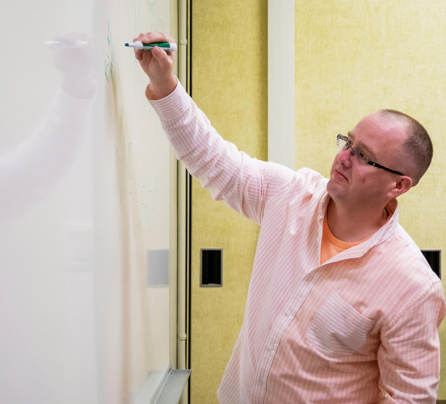 Assistant Professor of Marketing Bryan McLeod tells students they all have some experience with marketing.