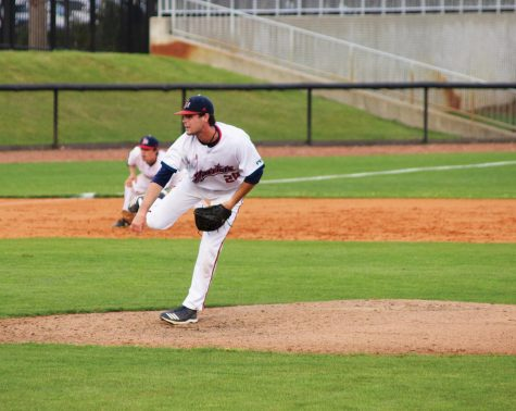 Christian Umphlett pitches at the April 13 game against Columbus State University.