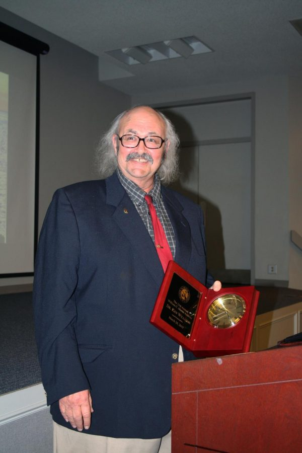 Professor of Chemistry Ken Williams poses with the 11th annual William C. Moran Address award.