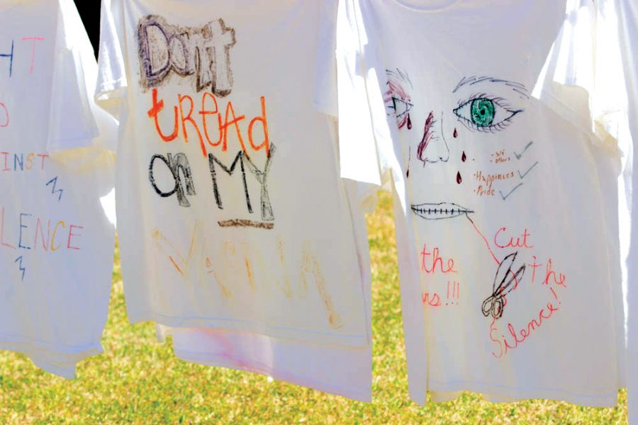 Shirts from the Clothesline Project hang on the lawn outside of Founder's Hall.