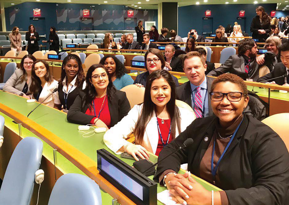 Left to right: Ashley Krause, Hunter Britt, Janine Gordon, Avonlea Samuel, Michelle Carter, Assistant Professor of Geography Jennifer Titanski-Hooper, Marisa Littlefield, Assistant Professor of Political Science William Daniel and Connor Graham pose at the National Model United Nations conference. Not pictured:  Lauren Fields.
