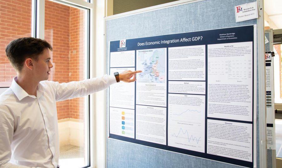 Matthew Bainbridge, an economics major, explains his research on economic integration and GDP.