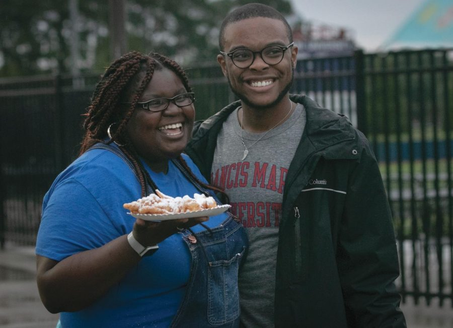Kaliyah Johnson and Tristan Shird enjoying some food from the festival.
