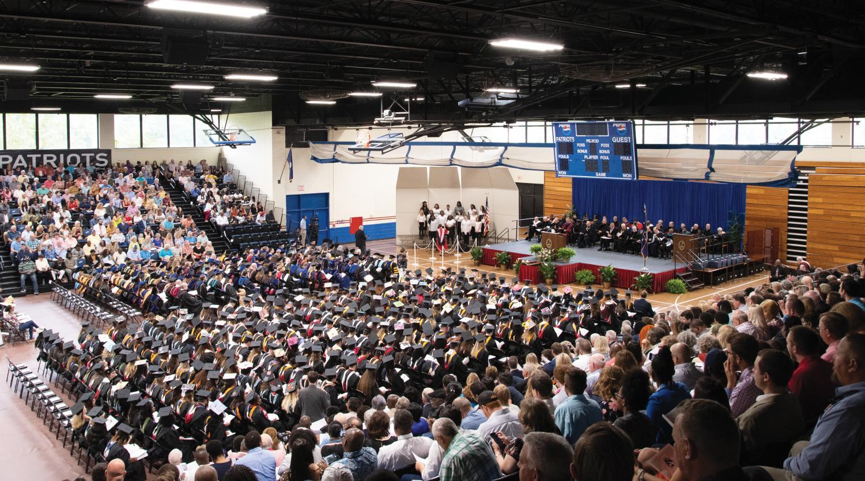 Graduates wait anxiously to receive their degrees.