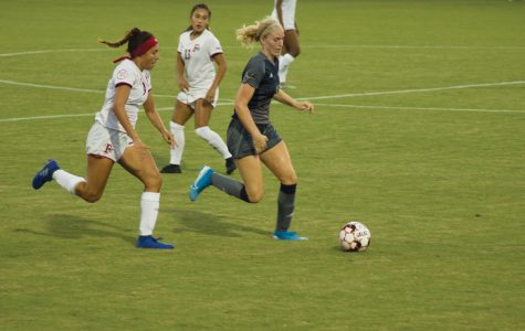 Zania Nava and Rianna Orello try to reclaim the ball from a Catawba College player.