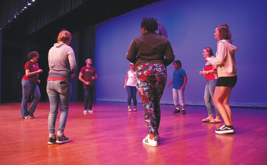 Students learn basic steps to Afro-Latin dances.