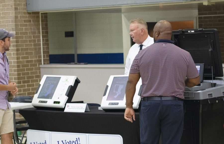Students have the opportunity to use new voting machines.