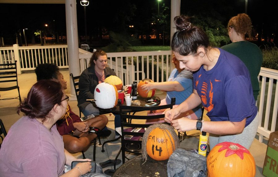 Honors students paint their Harry Potter-themed pumpkins at the Grille.