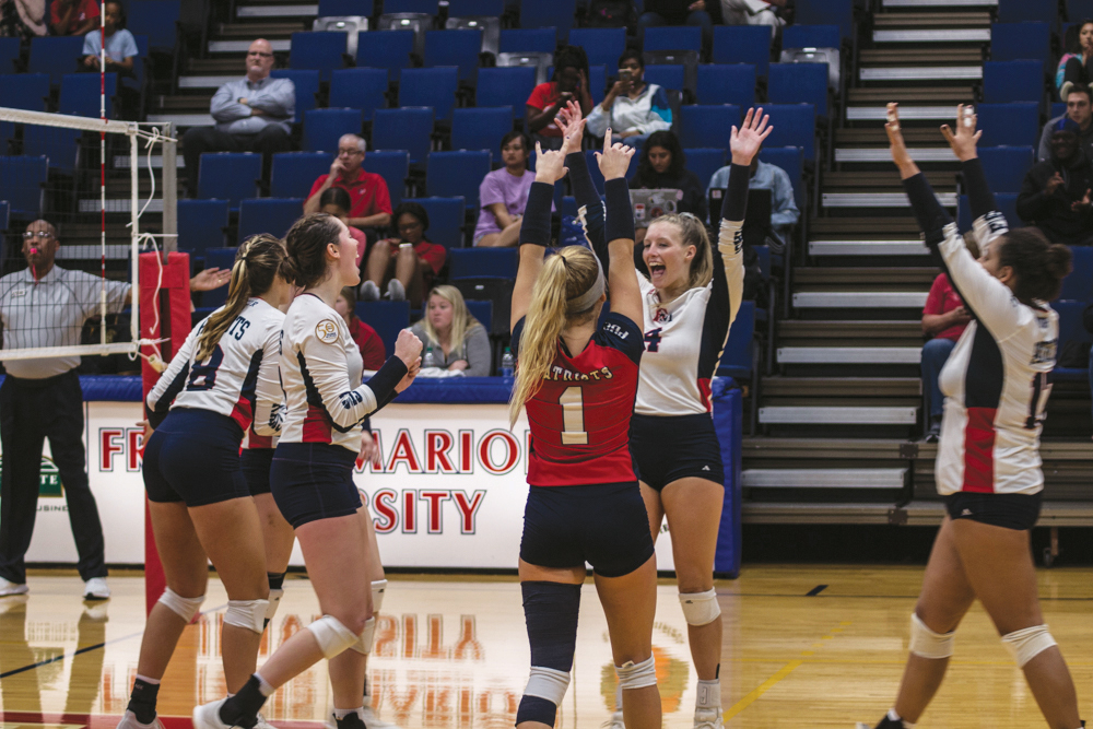 The Lady Pats celebrate after they score against Catawba College.