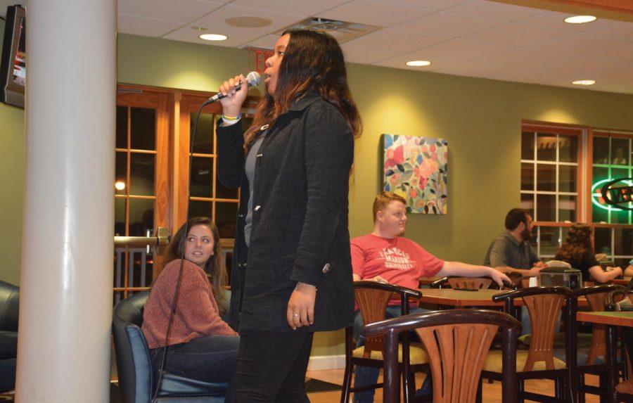 Caira Wilson performs at karaoke night.