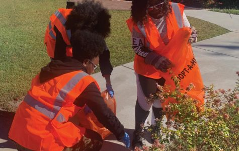 Members of the Green Club pick up trash along the two-mile stretch of highway in front of FMU.