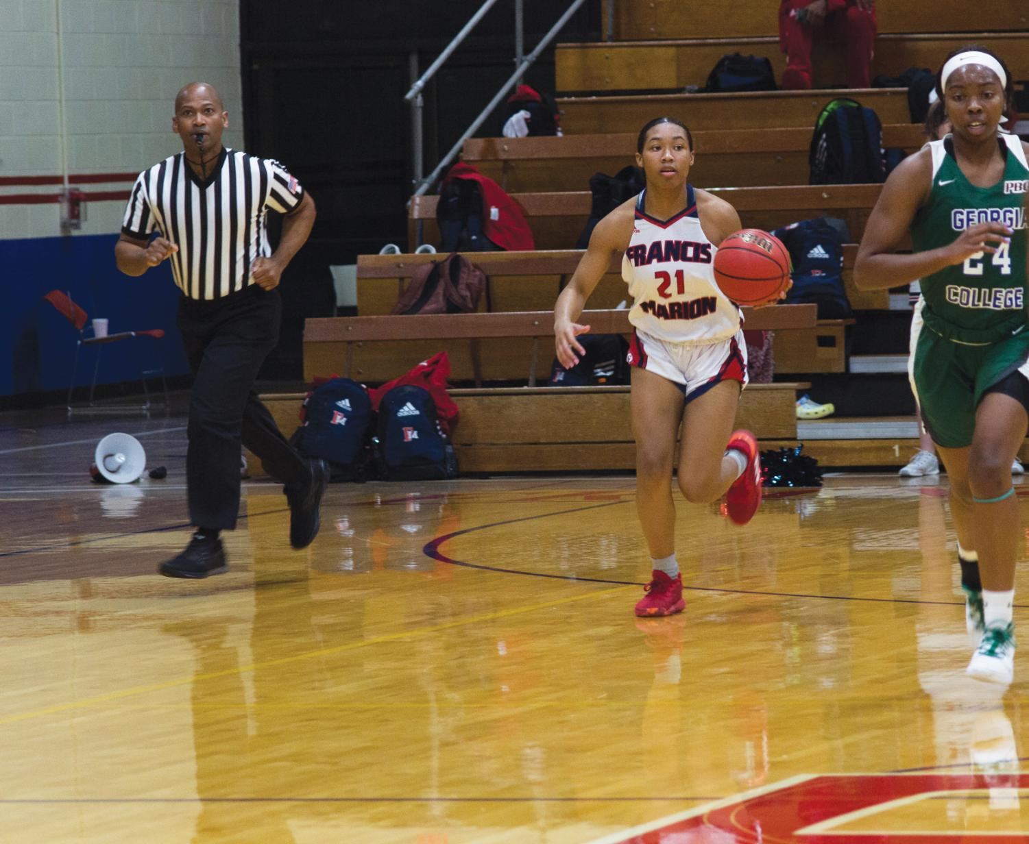 #21, Scarlett Gilmore, makes her way down the court.
