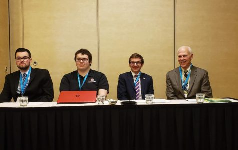 From left to right: Micheal Krasuski, Tyler Zeh, Samuel Day and Stephen Carls from different universities participate in a panel.