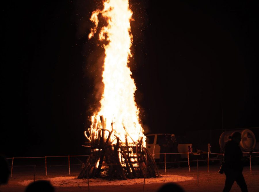The bonfire blazes at the soccer field behind the UC.