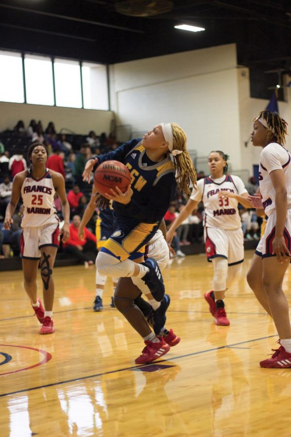 Women's basketball team defends against Georgia Southwestern.