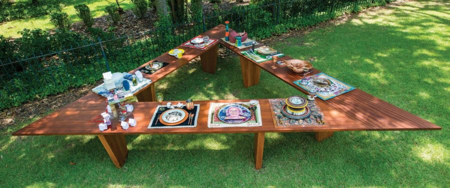 Triangle table with place-settings depicts twelve South Carolina women.