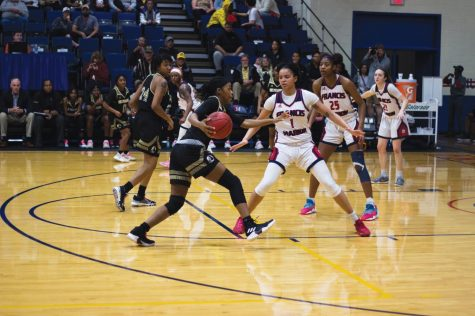 #1 Kiana Adderton and #25 Tatyana McClaney defend against UNC Pembroke.