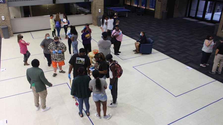 "Students try to solve the ""Murder Mystery"" by talking to suspects in the UC Commons."