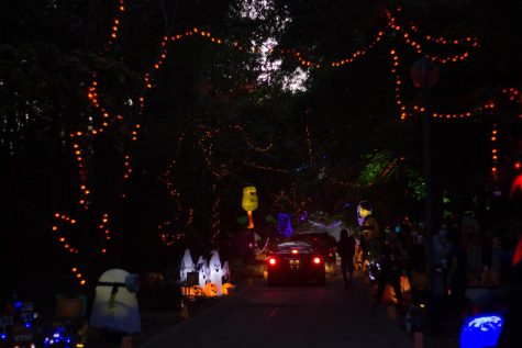 Sightseers drive through FM A'Glow to see the spooky decorations created by students and organizations.