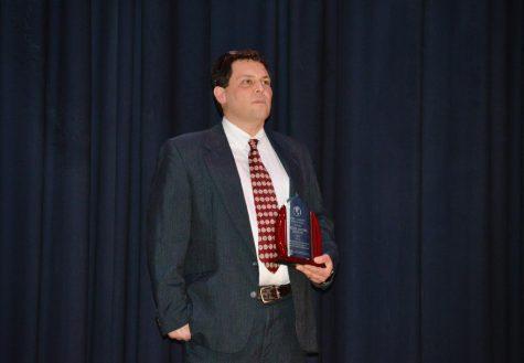 Professor Daniel Brauss holds the Diversity Award for his dedication to inclusivity through mathematics.