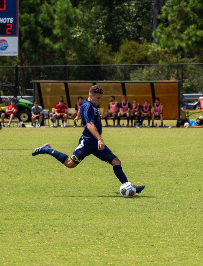 Young Harris forward heads the ball toward the net.