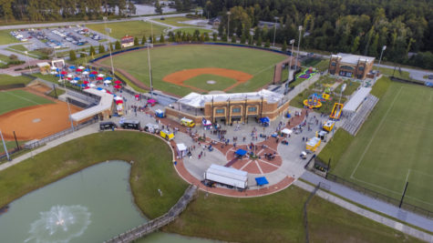 An aerial view of First Friday at FMU showcasing the tents, food trucks and rides.